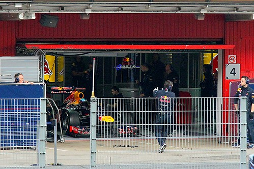 The Red Bull Racing car of Sebastian Vettel prepares to head out on track