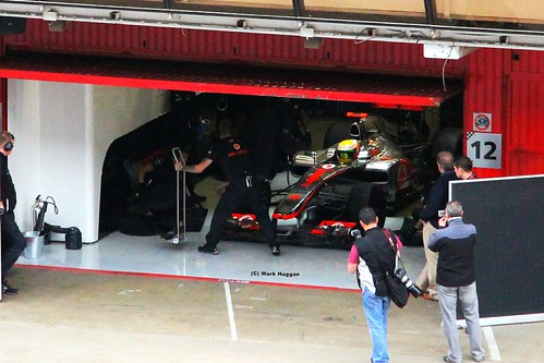 Lewis Hamilton prepares to come out of the garage in his McLaren at Formula One Winter Testing, Circuit de Catalunya, March 2012