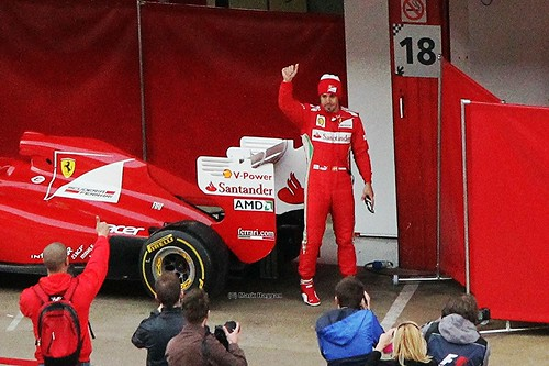 Fernando Alonso waves to fans after Formula One Winter Testing at the Circuit de Catalunya, March 2012
