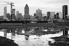 Montreal (Erik Lykins) Tags: city travel vacation urban blackandwhite bw canada reflection tower tourism water skyline night buildings reflections landscape outdoors lights canal spring downtown day waterfront skyscrapers quebec montreal cities tourist northamerica destination 20mm qc attraction bassinpeel 20mmf28 d7000