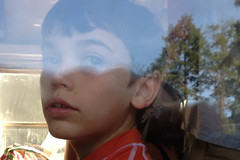 bound for camp (woodleywonderworks) Tags: school boy camp reflection bus window for eyes looking bound