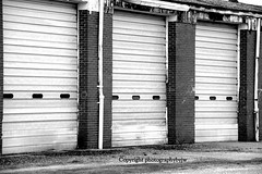 Behind the Doors Black and White (Photographybyjw) Tags: old white black found industrial doors north large rusty area carolina behind photographybyjw