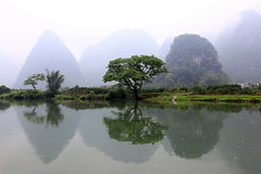 Yangshuo, China (on EXPLORE) (xiaomeisun ( I am back online )) Tags: china travel mist reflection rain fog river landscape moody yangshuo atmosphere guangxi countrysite canon5dmarkii xiaomeisun bestevergold