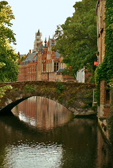Arched Bridge over one of Bruges Canals (Jeff Rose Photography) Tags: city travel bridge sunset reflection horizontal architecture outdoors photography canal europe cityscape belgium footbridge brugge nopeople bruges rowhouse tranquilscene archedbridge archbridge traveldestinations colorimage buildingexterior belgianculture jekaworldphotography jeffrosephotography kalitharosephotography