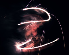 Entranced (Nate Conn) Tags: pink light portrait white man motion black blur night dark painting outside outdoors fire person model long exposure fireworks stripes magic 4th july works stare fourth sparks