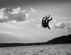 (Svein Nordrum) Tags: jump dive lake water bw blackandwhite noir nero nature landscape man scenery sky clouds summer summertime