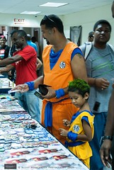Father and Son Quality Time (Nicky Highlander Photography) Tags: barbados animekon expo popculture convention caribbean culture cultural cute father man son boy costume cosplay cosplayers anime character human interest fun people goku gohan dragonballz candid event eventphotography indoor documentary life lifestyle orange colour colourful
