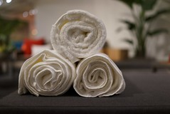 Three White Towels Rolled into Pyramid Design (Lynn Friedman) Tags: roomandboard decor sanfrancisco lynnfriedman home 94103 stockfav rolled towels display store party