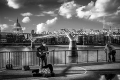 Say It Ain't So, Joe... (geoffroy C) Tags: fuji x100t london jpeg x100 x100s street 23mm xsensor fujifilm londres x blackwhite black white bw nb noirblanc noir blanc monochrome outdoor milleniumbridge millenium bridge tamise water stpaul cathedral singer guitar play song light lumire fujinon et dodgeburn dodge burn ngc