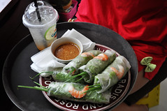 Lunch for one (Roving I) Tags: shrimps springonion springrolls cabanon cafes chilisauce drinks plasticcontainers vietnamesecuisine vietnam napkins trays dresses lunch danang dining