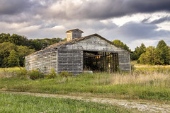 Other Old Barn at Pelican Lake (SteveFrazierPhotography.com) Tags: barn wooden old delapidated clouds trees treeline water reflections shore shoreline beautiful highway136 illinois il usa unitedstates america stevefrazierphotography