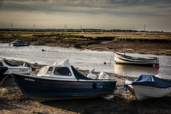 Boats at low tide (talksrm) Tags: drone norfolk wellsnextthesea sea seaside beach sand sandy sunny sunset evening twilight dji phantom 3 broads holkham hall frenchs fish shop plattens wells lifeboat pinewoods holiday road next marsh northnorfolk coast england dunes boat boats seal seals wetlands salt marshes freshwater lagoons or shingle beaches