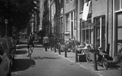 A bum (Arne Kuilman) Tags: akarette xenon 50mm lens ilford xp2 nederland netherlands handheld c41 bum zwerver man walking schneiderkreuznach xenon50mmf2
