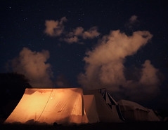 Under the Night Sky (trm42) Tags: alasin livinghistory galgberget medeltidsveckan medieval tents medievalweek dark night camp sky historianelävöitys visby highiso histel clouds