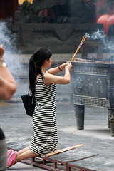 Lama temple  (BenValjean) Tags: china travel portrait female canon asian temple person eos chinese beijing   dslr lamatemple   500d   eos500d benjamingoodacre goodacrephotography