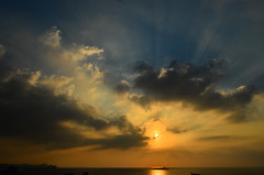 Sunset over the gulf of Beirut with rays piercing the clouds (vartkesn) Tags: city blue light sunset sea sky lebanon orange cloud sun white black reflection art water clouds port wow reflections wonderful dark gold nikon perfect flickr artist ship afternoon shadows shine power emotion bright artistic cloudy good smoke great shapes super best sharp sparkle shade winner excellent romantic 1755mmf28g rays emotional beirut incredible powerful shining soe carrete mediterraneansea puffyclouds informative remarkable autofocus nikkorlens verygood skytheme flickraward cloudbowl d7000 awesomeinformation mygearandme onlythebestofnature ringexcellence dblringexcellence tplringexcellence flickrstruereflection4 me2youphotographylevel1