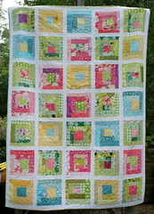 Sherbet Log Cabin Quilt (Cut To Pieces) Tags: pink blue green yellow quilt moda logcabin fabric scraps jellyroll biggirlbed logcabinquilt wavyquilting