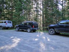 Three vehicles at end of road.