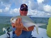 A BILOXI MISSISSIPPI FLORIDA POMPANO - Joseph Frame posing with a gorgeous Florida pompano he caught light tackle fishing aboard TEAM BRODIE CHARTERS - Photo by Capt. Robert L. Brodie (teambrodiecharters) Tags: sky fish gulfofmexico water clouds mississippi fishing biloxi surffishing pompano fishingcharters pomp barrierislands diberville hornisland bottomfishing beautifulfish floridapompano teambrodiecharters lighttacklefishing joeframe charterbot josephframe