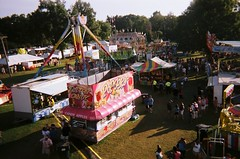 organized chaos (allison.johnston) Tags: people orange film tents popcorn disposablecamera rides filmcamera stands carni treees takenfromferriswheel