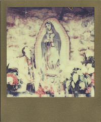 Nuestra Senora de Guadalupe (juli) Tags: newmexico polaroid sx70 altar chimayo ourladyofguadalupe ndfilter mof instantfilm santuariodechimayo goldframe roidweek colorshade theimpossibleproject px680 roidweek2012