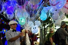 15 (Light Echoes) Tags: money fall night balloons orlando nikon mainstreet jake florida five balloon disneyworld dollar ten wdw waltdisneyworld fifteen 2011 d90 balloonvendor