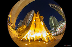 Golden Hollow (Clayton Perry Photoworks) Tags: vancouver bc canada summer explorebc explorecanada dailyhivevan cambiemarine canadaline night light art gold plastic hollowtree douglascoupland goldentree fisheye skyline buildings