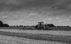 Ploughing in Essex (Rod Martins Photography) Tags: tractor plough earth sky clouds blackandwhite tyres furrow corn stubble trees landscape canon 5dmkiii john deere twins cultivator grubber grub grain