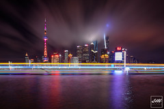 Pudong Skyline (Sunny Merindo | Photography) Tags: smerindo sunnymerindo sunnymerindoimages shanghai china pudong chinese architecture buildings cityscape riverside thebund lightshow lights ferry boat river huangpu longexposure reflection colorful clouds oriental pearl tower tallest office