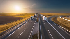 Flying (Radisa Zivkovic) Tags: truck highway transport road shipping travel freight sunset delivery fast motion blur speed orange autumn vehicle industry freeway motorway autobahn straight landscape sky field horizon diminishingperspective serbia aerial