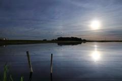 Milk of the Moon (John Andersen (JPAndersen images)) Tags: pond alberta night moonlight reflections fence posts clouds
