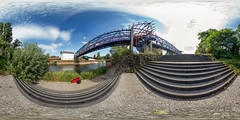 the lonely red umbrella (360 x 180) (diwan) Tags: germany deutschland sachsenanhalt saxonyanhalt magdeburg city stadt place buckau brcke bridge stahl steel zurfhre treppe stairs einsam lonely regenschirm umbrella meinefotoausrstung myphotographyequipment sonnig sonny outdoor fotogruppe fotogruppemagdeburg roundabout equirectangular spivpano 360 panoramix panorama stitch ptgui fisheye walimexprofisheye835 canon eos 650d 2016 geotagged geo:lon=11642895 geo:lat=52107323