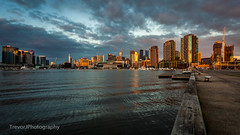 Victoria Harbour sunset (trevorjphotography) Tags: victoriaharbour melbourne australia waterscape cityscape skyscrapers newquay etihad stadium rialto goldenhour ripple wave reflection seascape scenic picturesque canoneos5dmarkii ef1740mmf4lusm wideanglelens marina boats ferry pier