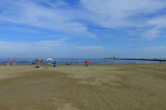 P1000004y (gzammarchi) Tags: italia paesaggio natura mare ravenna portocorsini ombrellone nuvola litorale persona