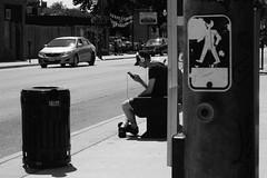 waiting for a bus (j. Verspeelt) Tags: street blackandwhite bw ontario canada bus digital pen waiting candid 8 olympus stop windsor jupiter ep2