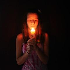pyromania (allison.johnston) Tags: shadow me girl self dark fire candle darkness lensflare pyro tealight pyromaniac pyromania