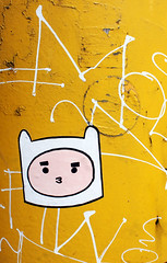 Hello (reena azim negi) Tags: white canada black west color colour cute tourism face lines yellow metal illustration vancouver graffiti coast sticker paint bc bright skin little sweet drawing britishcolumbia district cartoon vinyl ears canadian lips pole falsecreek northamerica hood inlet weathered had granvilleisland outline peninsula flaking eyebrows textured vancity vanlover vancouverites ilovevancouver