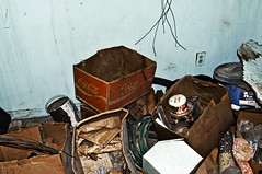 No Deposit No Return (Curtis Gregory Perry) Tags: california old blue house abandoned wall garden newspaper bucket garbage paint desert box coke center hose cardboard cocacola texaco boraxo