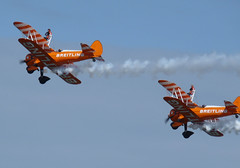 Good with heights (Eff Bee) Tags: blue sky orange colour clouds plane aircraft aviation stunt biplane aerobatics wingwalker 2011 teambreitling sunderlandairshow
