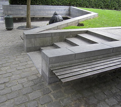 people from brussels (maximorgana) Tags: wood brussels tree green grass stairs bench grey back sitting belgium homeless steps lawn bin litter hedge raincoat seto adoquin