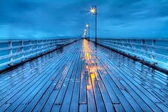 Shorncliffe Pier in HDR (Karl Muller) Tags: ocean blue light cloud reflection water rain pier australia brisbane hdr highdynamicrange canon7d karlmuller