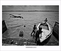 ghats of varanasi explored # 145 22nd Aug, 2012 (swarat_ghosh) Tags: street blackandwhite india monochrome boat interestingness jump divers nikon asia asians streetphotography explore varanasi swimmers tamron boatman ganges pradesh ghats benaras uttar kasi explored womenbathing d3000 1024mm lifeatghats