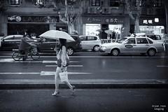 walking in the rain (bryan-roos) Tags: china leica woman rain umbrella shanghai taxi   leicam9