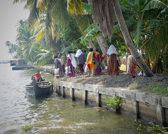 A Day Of Shopping (2) (The Spirit of the World) Tags: shopping women saris canoe boat india kerala southernindia backwaters lake water dailylife afternoon locals shore shoreline waterflowers