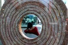 woman reclining (overthemoon) Tags: switzerland suisse schweiz svizzera romandie vaud lausanne flon sculpture alexiaweill circular hole woman through throughglass blurry utata:project=lookingthrough