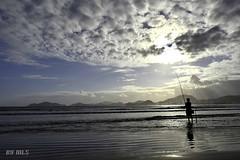 CARPE DIEM (Maria Luiza S) Tags: fisherman pescador fishing pescar beach praia enseada guaruja clouds nvens silhouettes silhuetas blue azul sea mar