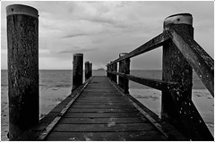 the call of the ocean (kurtwolf303) Tags: fhr insel holzsteg nordfriesland germany deutschland meer ocean ship schiff monochrome bw sw olympusem1 omd microfourthirds micro43 systemcamera perspective beachscape unlimitedphotos travelphotography reisefotografie topf25 wyk topf50 250v10f 500v20f topf75 topf100 schleswigholstein 750views 800views 1000v40f topf150 1500v60f