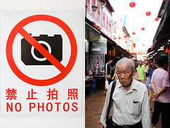 china town - singapore (Emmanuel Catteau photography) Tags: china street old travel portrait man tourism lamp face town singapore holidays photographer market photos no reporter traveller forbidden human national journey signage planet conde lonely geo geographic nast catteau wwwemmanuelcatteaucom