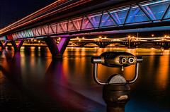 Sight Seeing (Michael Manges) Tags: nightphotography light arizona reflection water train lowlight az binoculars lightrail tempe tempetownlake lighttrail phoenixlightrail