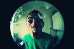 Blowin O's (JDshotyou) Tags: boy green eye art canon lens photography high o brother smoke hipster smoking fisheye tricks indie trippy ovoxo
